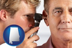 alabama an audiologist examining the ear of a patient