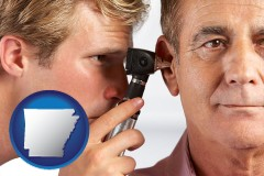 arkansas an audiologist examining the ear of a patient