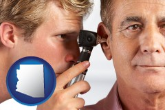 arizona an audiologist examining the ear of a patient