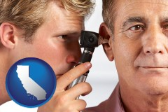 california an audiologist examining the ear of a patient