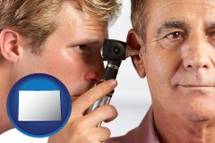 colorado an audiologist examining the ear of a patient