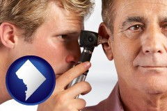 washington-dc an audiologist examining the ear of a patient