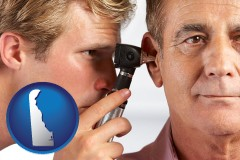 delaware an audiologist examining the ear of a patient