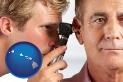 hawaii an audiologist examining the ear of a patient