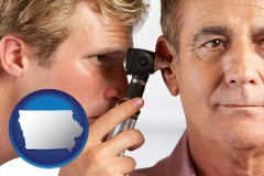 iowa an audiologist examining the ear of a patient