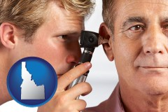 idaho an audiologist examining the ear of a patient