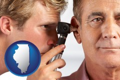 illinois an audiologist examining the ear of a patient