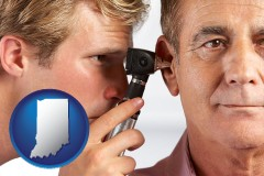 indiana an audiologist examining the ear of a patient