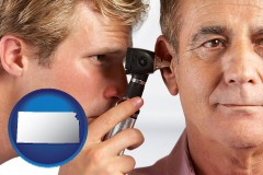 kansas an audiologist examining the ear of a patient