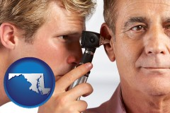 maryland an audiologist examining the ear of a patient
