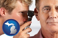 michigan an audiologist examining the ear of a patient