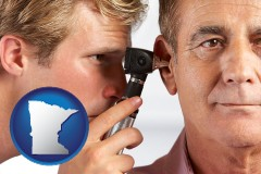 minnesota an audiologist examining the ear of a patient
