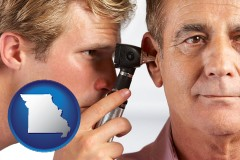missouri an audiologist examining the ear of a patient