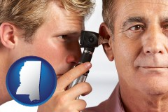 mississippi an audiologist examining the ear of a patient