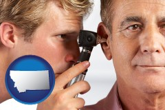 montana an audiologist examining the ear of a patient