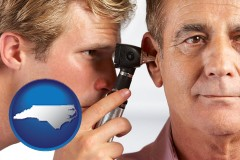north-carolina an audiologist examining the ear of a patient