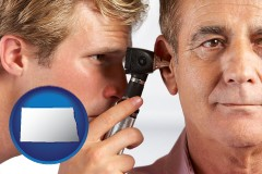 north-dakota an audiologist examining the ear of a patient