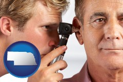 nebraska an audiologist examining the ear of a patient