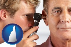 new-hampshire an audiologist examining the ear of a patient