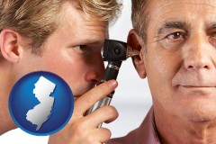 new-jersey an audiologist examining the ear of a patient