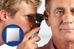 new-mexico map icon and an audiologist examining the ear of a patient