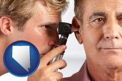 nevada an audiologist examining the ear of a patient