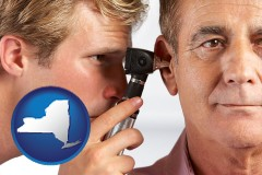 new-york an audiologist examining the ear of a patient