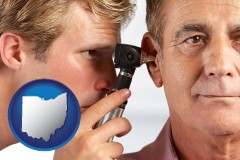 ohio an audiologist examining the ear of a patient