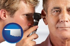 oklahoma an audiologist examining the ear of a patient