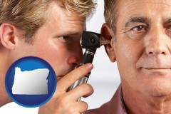 oregon an audiologist examining the ear of a patient