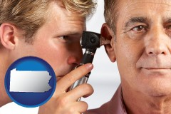 pennsylvania an audiologist examining the ear of a patient