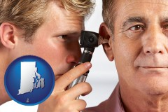 rhode-island an audiologist examining the ear of a patient