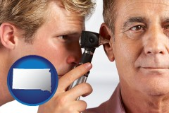 south-dakota an audiologist examining the ear of a patient