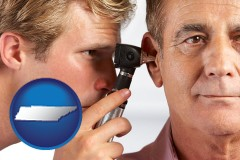 tennessee an audiologist examining the ear of a patient