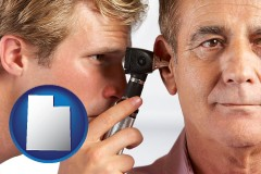 utah an audiologist examining the ear of a patient