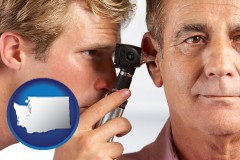 washington an audiologist examining the ear of a patient