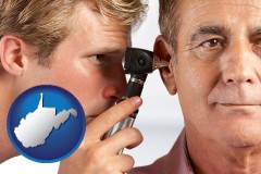 west-virginia an audiologist examining the ear of a patient