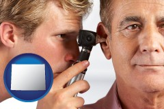 wyoming an audiologist examining the ear of a patient