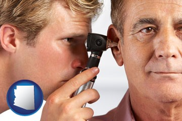 an audiologist examining the ear of a patient - with Arizona icon