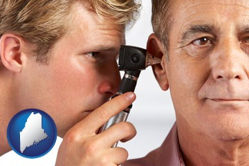 an audiologist examining the ear of a patient - with Maine icon