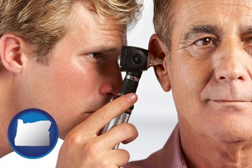 an audiologist examining the ear of a patient - with Oregon icon