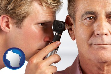 an audiologist examining the ear of a patient - with Wisconsin icon